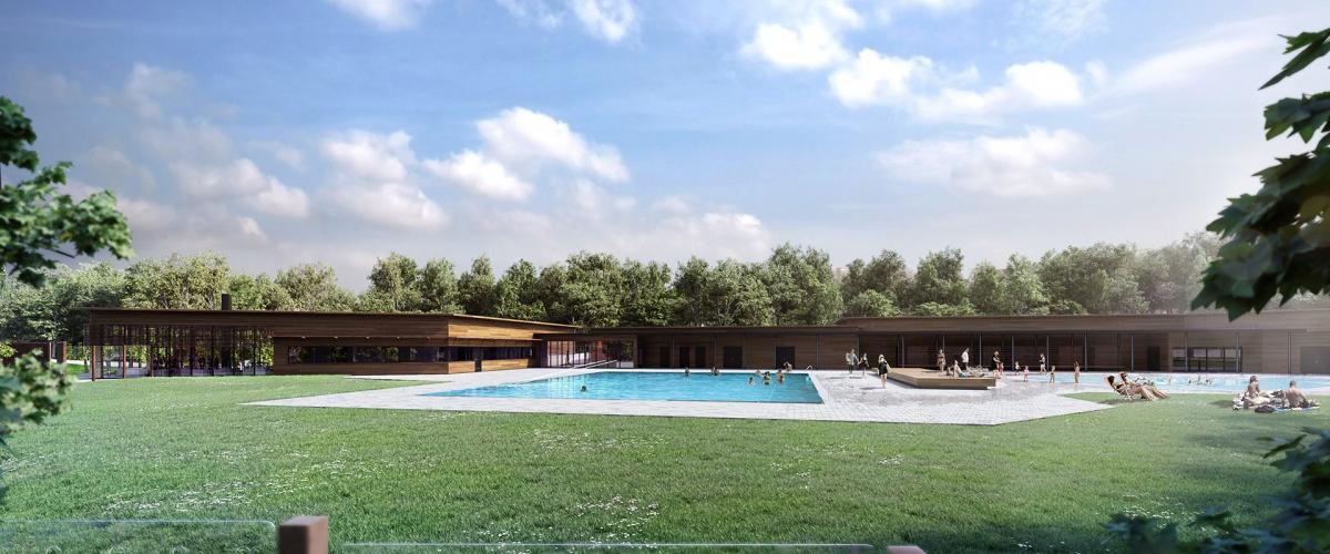 Fasade av grøntområder med utendørs svømmebasseng og anlegg i bakgrunnen